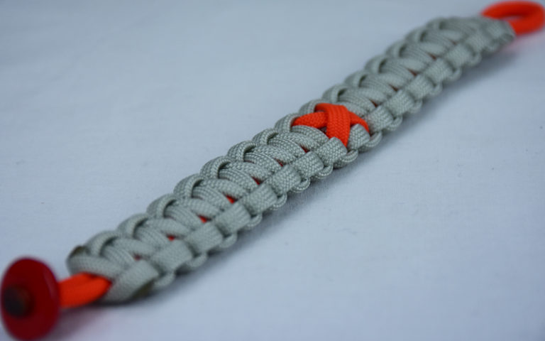 orange and grey leukemia support paracord bracelet with red button corner and orange ribbon