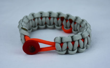 orange and grey leukemia support paracord bracelet with red button front and orange ribbon