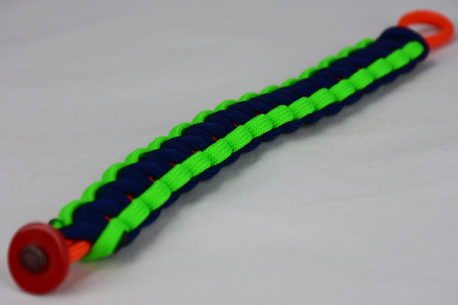 orange neon green and navy blue paracord bracelet unity band with red button in the corner, picture of an orange neon green and navy blue paracord bracelet unity band with red button fastener in the front corner on a white background