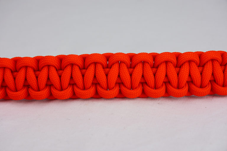 orange paracord bracelet unity band, picture of an orange paracord bracelet across the center