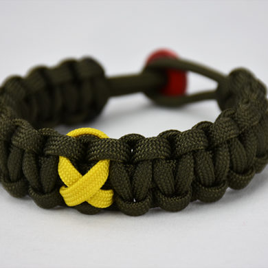 od green military support paracord bracelet with yellow support ribbon, picture of an od green paracord bracelet with a yellow ribbon in the center of it and a red button for a fastener, od green military support paracord bracelet unity band