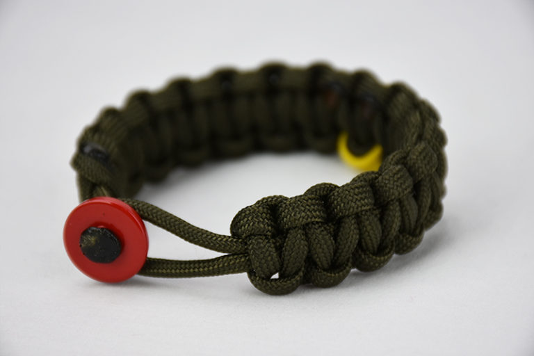 od green military support paracord bracelet with red button, picture of a unity band od green military support paracord bracelet with a yellow support ribbon in the back and red button in the front