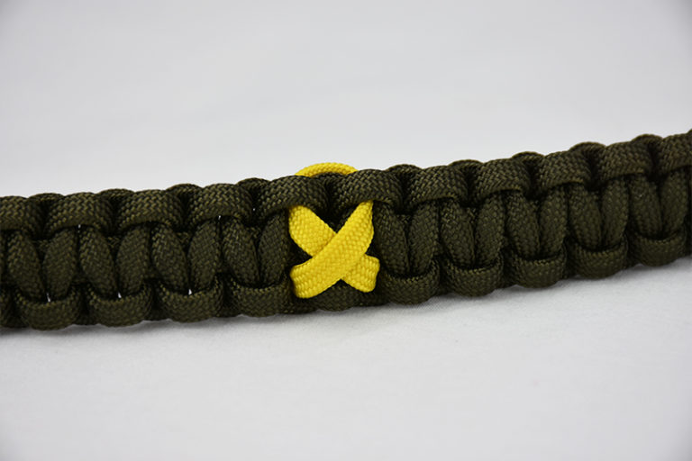 od green military support paracord bracelet unity band, picture of a od green military support paracord bracelet with a yellow ribbon in the center