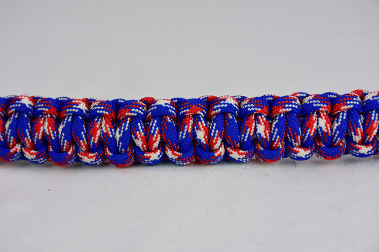patriot camouflage paracord bracelet across the center of a white background