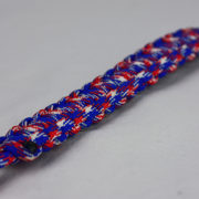 patriotic camouflage paracord bracelet unity band with red button in the corner on a white background