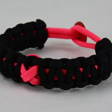 pink and black breast cancer support paracord bracelet with red button back and pink ribbon