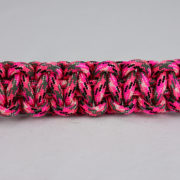 pink camouflage paracord bracelet unity band across the center of a white background