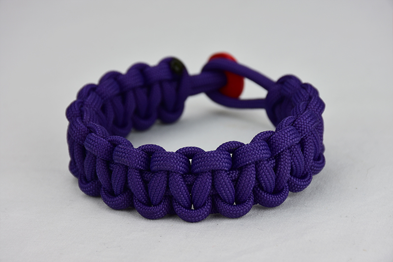 purple paracord bracelet unity band, picture of a purple paracord bracelet with a red button fastener