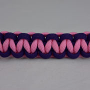 purple purple and soft pink paracord bracelet unity band going across the center of a white background