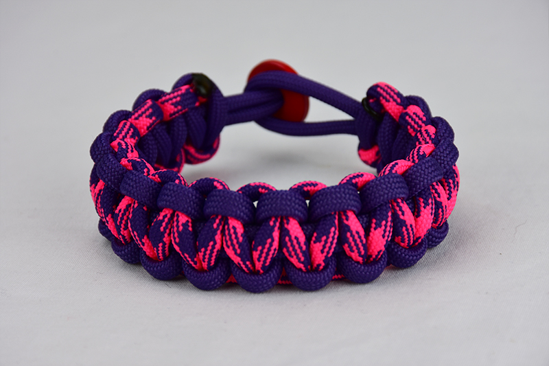 purple purple pink and purple camouflage paracord bracelet unity band with red button in the back, picture of a purple purple pink and purple camouflage paracord bracelet unity band with red button fastener in the back on a white background