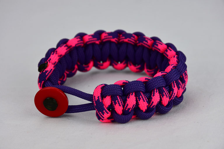 purple purple pink and purple camouflage paracord bracelet unity band with red button in the front, picture of a purple purple pink and purple camouflage paracord bracelet unity band with red button fastener in the front on a white background