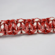 red and white camouflage paracord bracelet unity band across the center of a white background