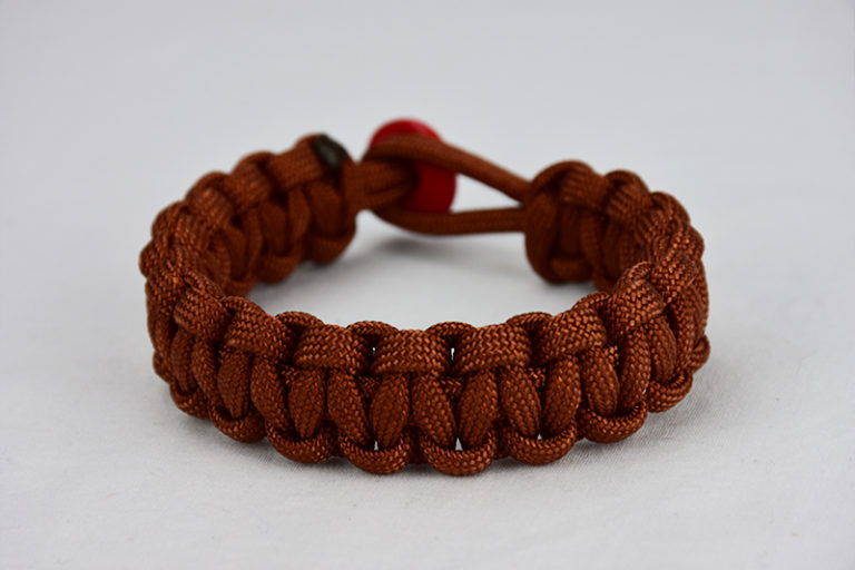 rust paracord bracelet unity band with red button, picture of a rust paracord bracelet unity band with a red button fastener on a white background