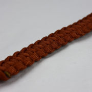rust paracord bracelet unity band with red button, picture of a rust paracord bracelet unity band with red button fastener in the corner