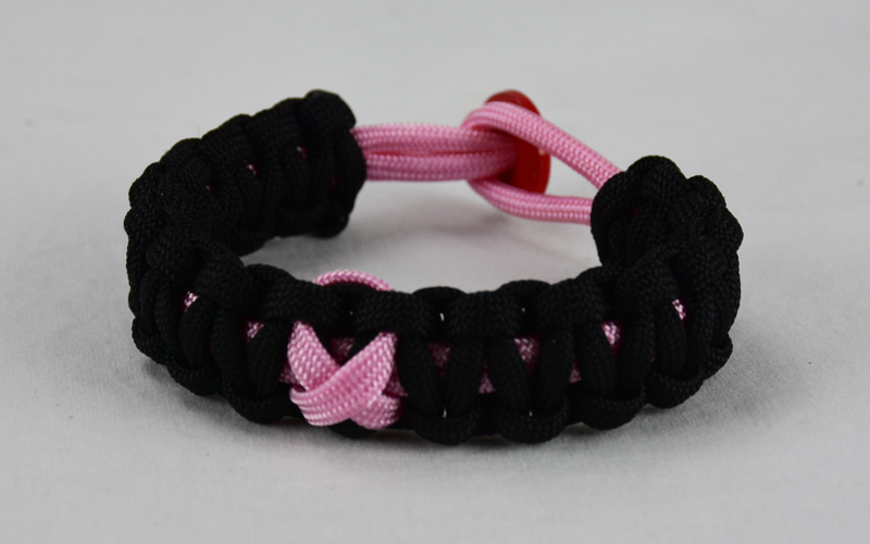 soft pink and black breast cancer support paracord bracelet with red button back and soft pink ribbon