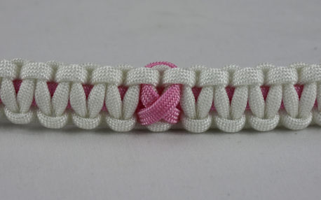 soft pink and white breast cancer support paracord bracelet with soft pink ribbon center
