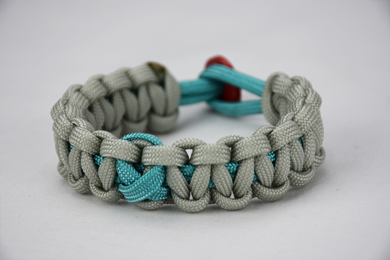 teal and grey ptsd support paracord bracelet with teal ribbon and red button, picture of a teal and grey ptsd support paracord bracelet unity band with a teal ribbon in the center and red button fastener