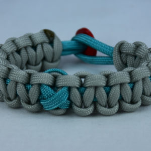 teal and grey ptsd support paracord bracelet with red button back and teal ribbon