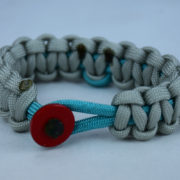 teal and grey ptsd support paracord bracelet with red button front and teal ribbon