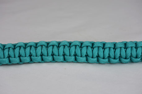teal paracord bracelet unity band across the center of a white background