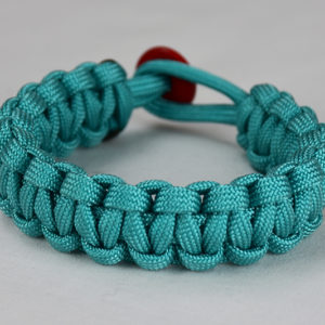 teal paracord bracelet unity band with red button in back, picture of a teal paracord bracelet unity band with red button fastener in the back on a white background