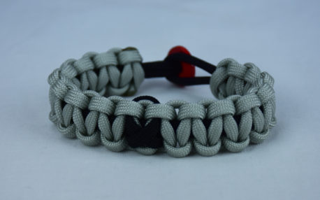 black and grey pow mia support paracord bracelet with red button back and black ribbon