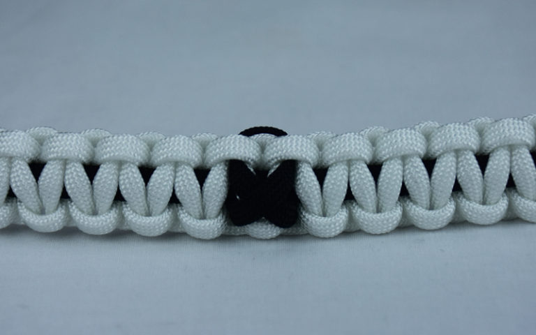 black and white pow mia support paracord bracelet with black ribbon in the center