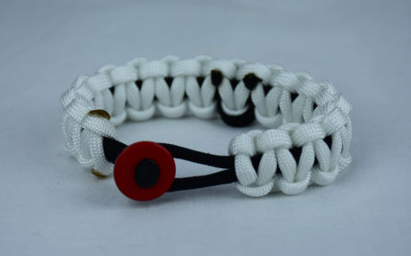 black and white pow mia support paracord bracelet with red button in the front and black ribbon
