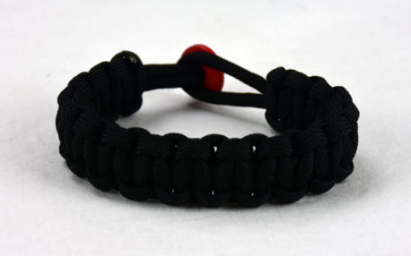 black paracord bracelet with red button back