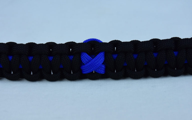 blue and black anti-bullying paracord bracelet with blue ribbon in the center