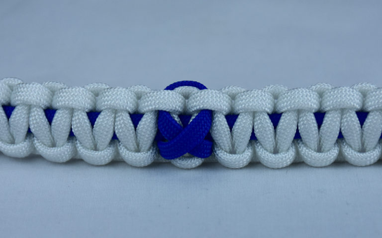 blue and white anti-bullying paracord bracelet with blue ribbon in the center