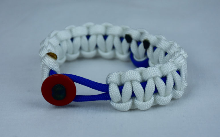 blue and white anti-bullying paracord bracelet with red button front and blue ribbon