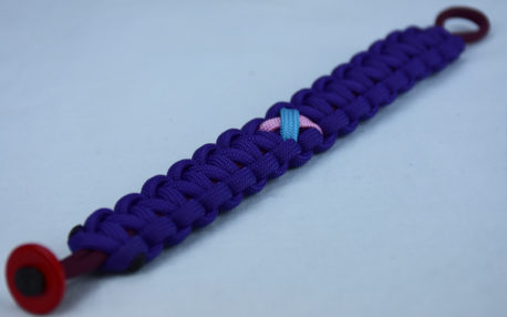 burgundy and purple sids support paracord bracelet with red button in the corner and tarheel blue and pink ribbon