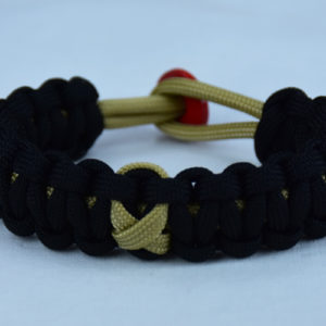 gold and black pediatric cancer support paracord bracelet with red button back and gold ribbon
