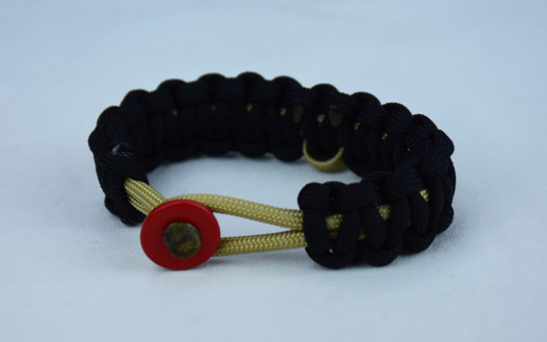 gold and black pediatric cancer support paracord bracelet with red button front and gold ribbon