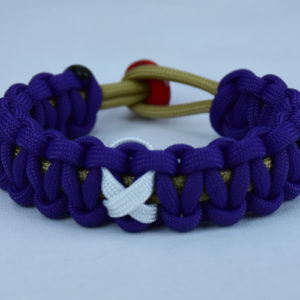 gold and purple multiple sclerosis support paracord bracelet with red button back and white ribbon