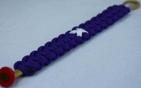gold and purple multiple sclerosis support paracord bracelet with red button corner and white ribbon