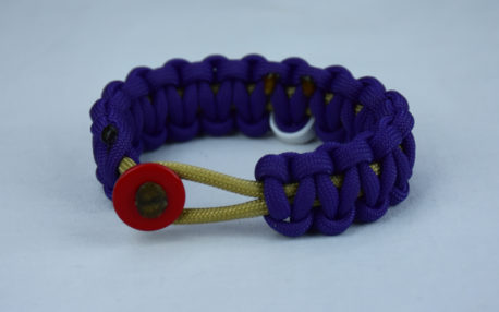 gold and purple multiple sclerosis paracord bracelet with red button front and white ribbon
