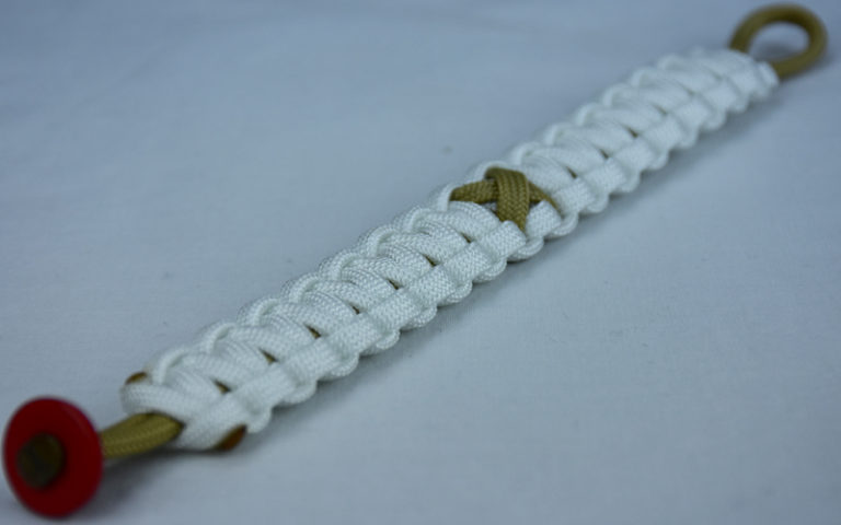 gold and white pediatric cancer support paracord bracelet with red button fastener in the front corner and gold ribbon