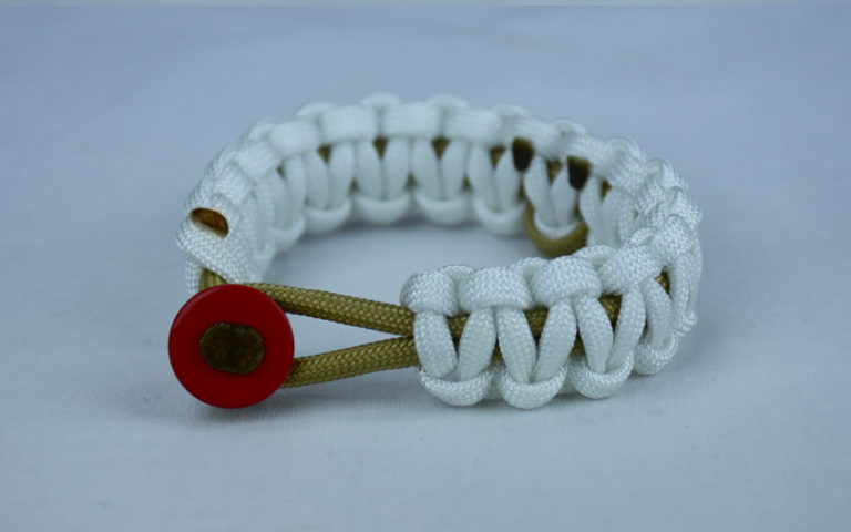gold and white pediatric cancer support paracord bracelet with red button front and gold ribbon