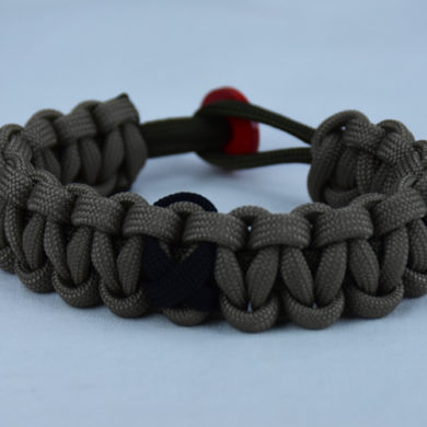od green and tan pow mia support paracord bracelet with red button back and black ribbon