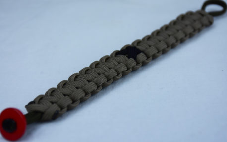 od green and tan pow mia support paracord bracelet with red button in corner and black ribbon