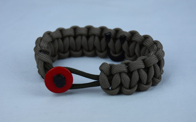 od green and tan pow mia support paracord bracelet with red button front and black ribbon