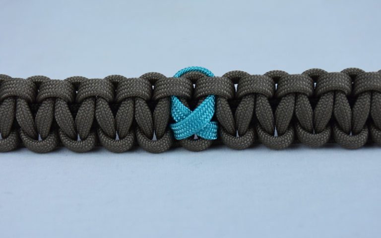 od green and tan ptsd support paracord bracelet with center teal ribbon