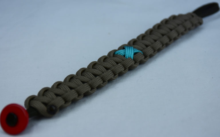 od green and tan ptsd support paracord bracelet with red button in the corner and teal ribbon