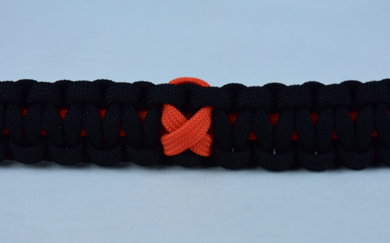 orange and black leukemia support paracord bracelet with orange ribbon in the center