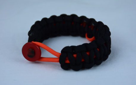 orange and black leukemia support paracord bracelet with red button front and orange ribbon