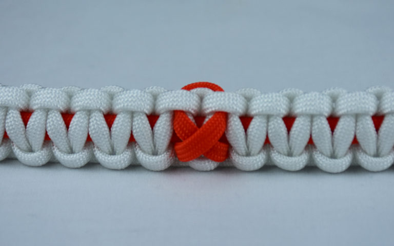 orange and white leukemia support paracord bracelet with ribbon in the center