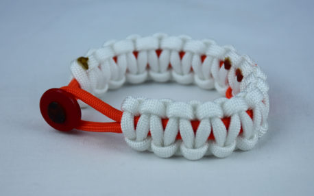 orange and white leukemia support paracord bracelet with red button in the front and orange ribbon
