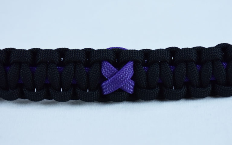 purple and black alzheimers support paracord bracelet with purple ribbon in the center